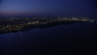 AX81_005 - 5K stock footage aerial video of Delaware River and city lights in North Philadelphia, Pennsylvania, Night
