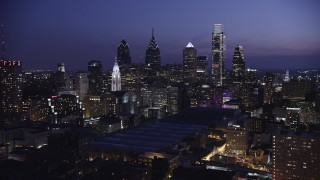 AX81_014 - 5K stock footage aerial video of Downtown Philadelphia skyscrapers, Pennsylvania Convention Center, and City Hall, Pennsylvania, Night