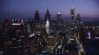 AX81_015 - 5K stock footage aerial video of Downtown Philadelphia skyscrapers and the City Hall clock tower, Pennsylvania, Night