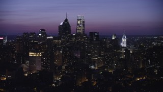 AX81_018 - 5K stock footage aerial video of Downtown Philadelphia skyscrapers and the City Hall clock tower in Pennsylvania at Night