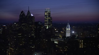 AX81_019 - 5K stock footage aerial video of Downtown Philadelphia's tall skyscrapers and the City Hall clock tower, Pennsylvania, Night