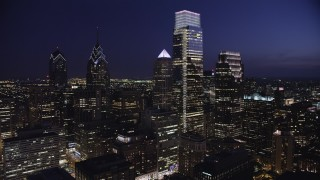 AX81_022 - 5K stock footage aerial video flying by Comcast Center, Three Logan Square in Downtown Philadelphia, Pennsylvania, Night