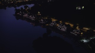 AX81_025 - 5K stock footage aerial video of Boathouse Row lit up at night, Philadelphia, Pennsylvania