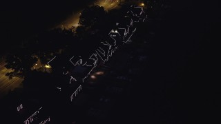 AX81_026 - 5K stock footage aerial video flying by Boathouse Row with lights at night, Philadelphia, Pennsylvania