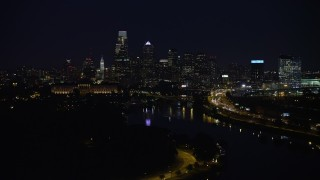 AX81_027 - 5K stock footage aerial video of Philadelphia Museum of Art, Schuylkill River and the Downtown Philadelphia skyline, Pennsylvania, Night