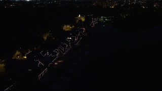AX81_029 - 5K stock footage aerial video of Boathouse Row with lights at night in Philadelphia, Pennsylvania