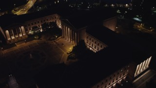 AX81_032 - 5K stock footage aerial video orbiting the Philadelphia Museum of Art and fountain, Pennsylvania, Night