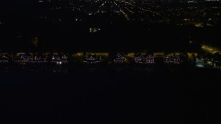 AX81_033 - 5K stock footage aerial video of Boathouse Row by the Schuylkill River at night in Philadelphia, Pennsylvania