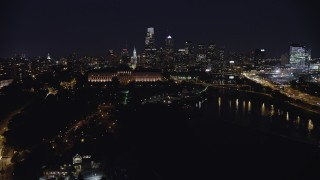 AX81_034 - 5K stock footage aerial video approaching Philadelphia Museum of Art, Downtown Philadelphia skyline in the background, Pennsylvania, Night