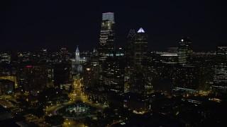 AX81_036E - 5K stock footage aerial video following Benjamin Franklin Parkway toward City Hall and Downtown Philadelphia skyline, Pennsylvania, Night