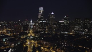 AX81_037 - 5K stock footage aerial video flying over Logan Square to approach Philadelphia City Hall in Downtown Philadelphia, Pennsylvania, Night