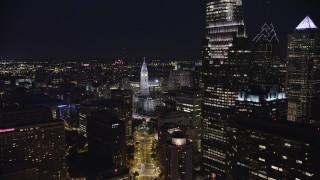 AX81_038 - 5K stock footage aerial video approaching Philadelphia City Hall in Downtown Philadelphia, Pennsylvania, Night
