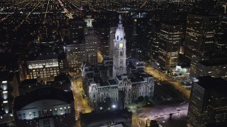 AX81_040 - 5K stock footage aerial video tracking Philadelphia City Hall to reveal Downtown Philadelphia skyscrapers, Pennsylvania, Night