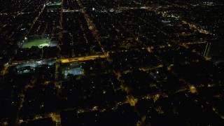 AX81_043 - 5K stock footage aerial video of urban neighborhoods and baseball fields in South Philadelphia, Pennsylvania, Night