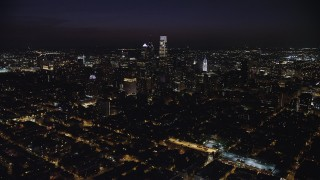 AX81_062 - 5K stock footage aerial video approaching Downtown Philadelphia, Pennsylvania, Night