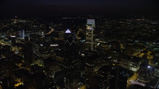 AX81_064 - 5K stock footage aerial video flying over Downtown Philadelphia's tall skyscrapers to reveal Philadelphia Museum of Art, Pennsylvania, Night