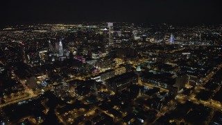 AX81_067 - 5K stock footage aerial video flying over I-676 to approach Downtown Philadelphia skyscrapers and city hall, Pennsylvania, Night