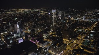 AX81_068 - 5K stock footage aerial video flying by City Hall and over Downtown Philadelphia's skyscrapers, Pennsylvania, Night