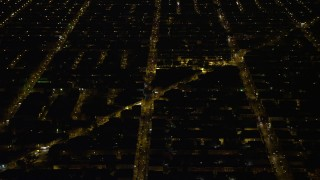 AX81_070 - 5K stock footage aerial video of urban neighborhoods and city streets, South Philadelphia, Pennsylvania Night