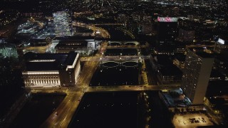AX81_071 - 5K stock footage aerial video of small bridges spanning Schuylkill River by office buildings, Philadelphia, Pennsylvania Night