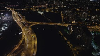 AX81_072 - 5K stock footage aerial video following Schuylkill River to approach Philadelphia Museum of Art, Pennsylvania, Night