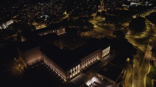 AX81_074 - 5K stock footage aerial video orbiting Philadelphia Museum of Art, tilt up to reveal Downtown Philadelphia skyline, Pennsylvania, Night