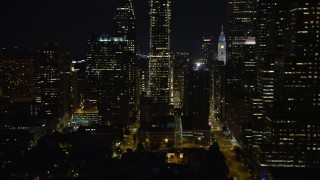 AX81_076 - 5K stock footage aerial video flying by Downtown Philadelphia skyscrapers and streets, Pennsylvania, Night