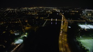 AX81_077 - 5K stock footage aerial video approaching and tilting to South Street Bridge over the Schuylkill River, Philadelphia, Pennsylvania, Night