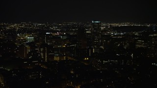 AX81_081 - 5K stock footage aerial video flying by Downtown Philadelphia apartment and office buildings, Pennsylvania, Night