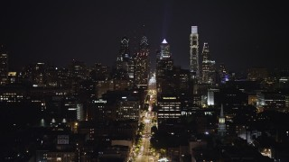 AX81_090 - 5K stock footage aerial video of the Downtown Philadelphia skyline, reveal Customs House, Pennsylvania, Night