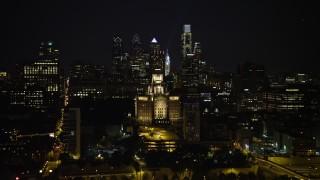 AX81_090E - 5K stock footage aerial video of the Downtown Philadelphia skyline, reveal Customs House and historic ship, Pennsylvania, Night