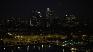 AX81_093 - 5K stock footage aerial video of Downtown Philadelphia skyline, reveal The Residences at Dockside condo complex, Pennsylvania, Night