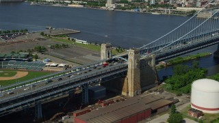 AX82_003 - 5K stock footage aerial video panning across Benjamin Franklin Bridge to reveal Downtown Philadelphia skyline, Pennsylvania