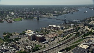 AX82_006 - 5K stock footage aerial video of Benjamin Franklin Bridge and Delaware River, Philadelphia, Pennsylvania