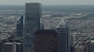 AX82_010 - 5K stock footage aerial video of rooftops of Downtown Philadelphia's tallest skyscrapers, Pennsylvania
