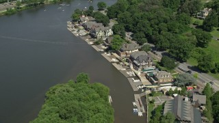 AX82_020 - 5K stock footage aerial video flying over Boathouse Row by the Schuylkill River, Philadelphia, Pennsylvania