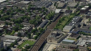 AX82_025 - 5K stock footage aerial video tilting from train tracks in North Philly, and reveal Downtown Philadelphia skyline, Pennsylvania