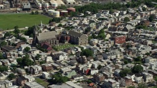 AX82_031 - 5K stock footage aerial video of All Saints Catholic Church and cemetery, North Philadelphia, Pennsylvania