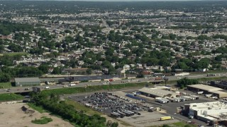 AX82_032 - 5K stock footage aerial video of Interstate 95 and urban neighborhoods, Philadelphia, Pennsylvania