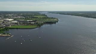 AX82_034 - 5K stock footage aerial video of boats in the Delaware River, Philadelphia, Pennsylvania