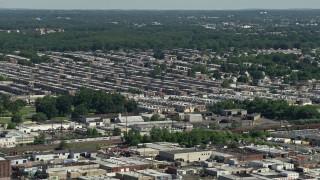 AX82_035 - 5K stock footage aerial video of row houses in an urban neighborhood, Philadelphia, Pennsylvania