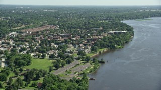 AX82_037 - 5K stock footage aerial video of apartment buildings and homes beside the Delaware River, Philadelphia, Pennsylvania
