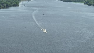 AX82_039 - 5K stock footage aerial video of fishing boat on the Delaware River, Philadelphia, Pennsylvania