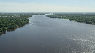 AX82_040 - 5K stock footage aerial video of Delaware River bordered by trees in Bensalem, Pennsylvania