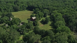AX82_041 - 5K stock footage aerial video of a barn on a small farm in Bensalem, Pennsylvania