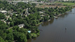 AX82_042 - 5K stock footage aerial video of waterfront homes by the Delaware River in Bensalem, Pennsylvania