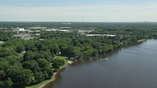 AX82_043 - 5K stock footage aerial video of warehouse buildings by the Delaware River, Bensalem, Pennsylvania