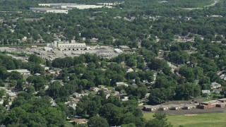 AX82_045 - 5K stock footage aerial video of a small factory and homes in Croydon, Pennsylvania