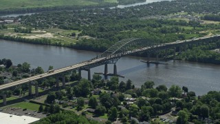 AX82_051 - 5K stock footage aerial video flying by the Delaware River Bridge, Bristol, Pennsylvania