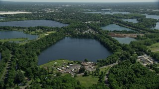 AX82_055 - 5K stock footage aerial video flying over small lakes and lakeside homes in Morrisville, Pennsylvania
